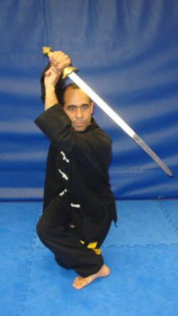 Parade à la tête avec l'épée Tai Chi