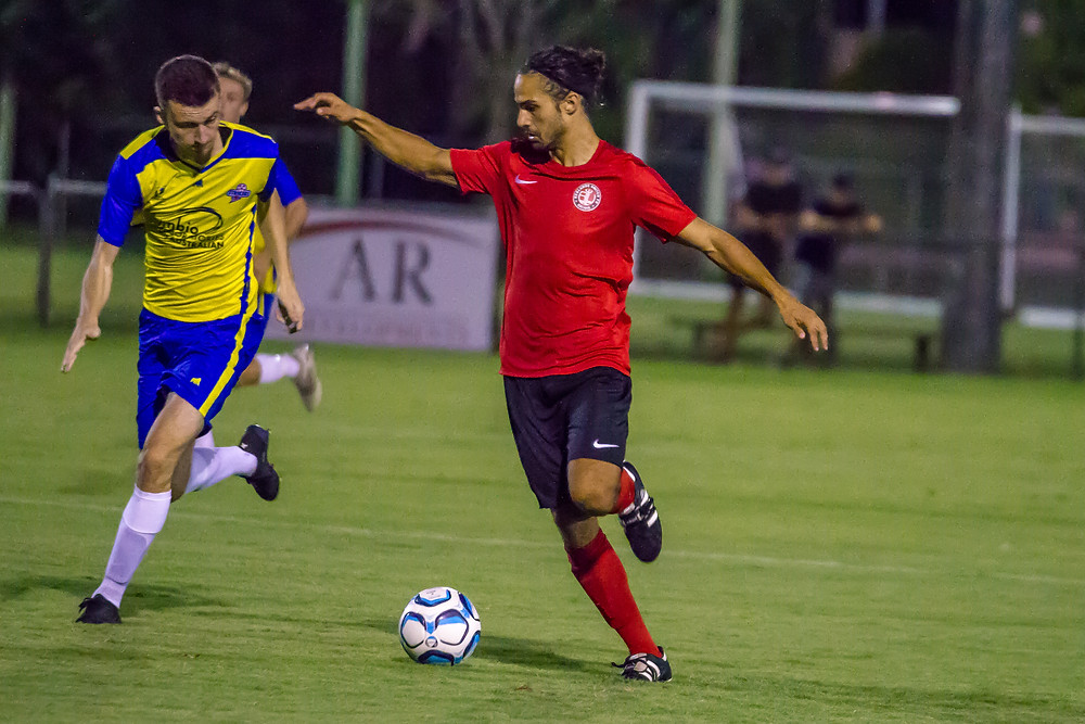 """""""Fernando Perez on the ball as Redlands United took on the Brisbane Strikers Friday Night at the Showgrounds""""  Photo Ray Gardner"""