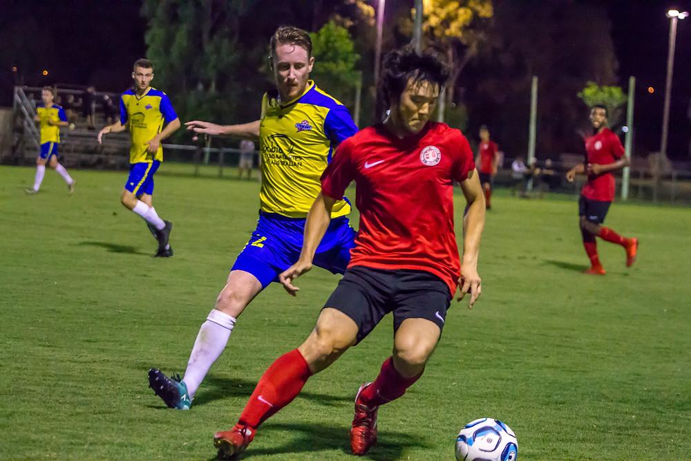 """Redlands United's dangerman Shuto Kuboyama takes on the Brisbane Strikers defence""  Photo  Ray Gardner"