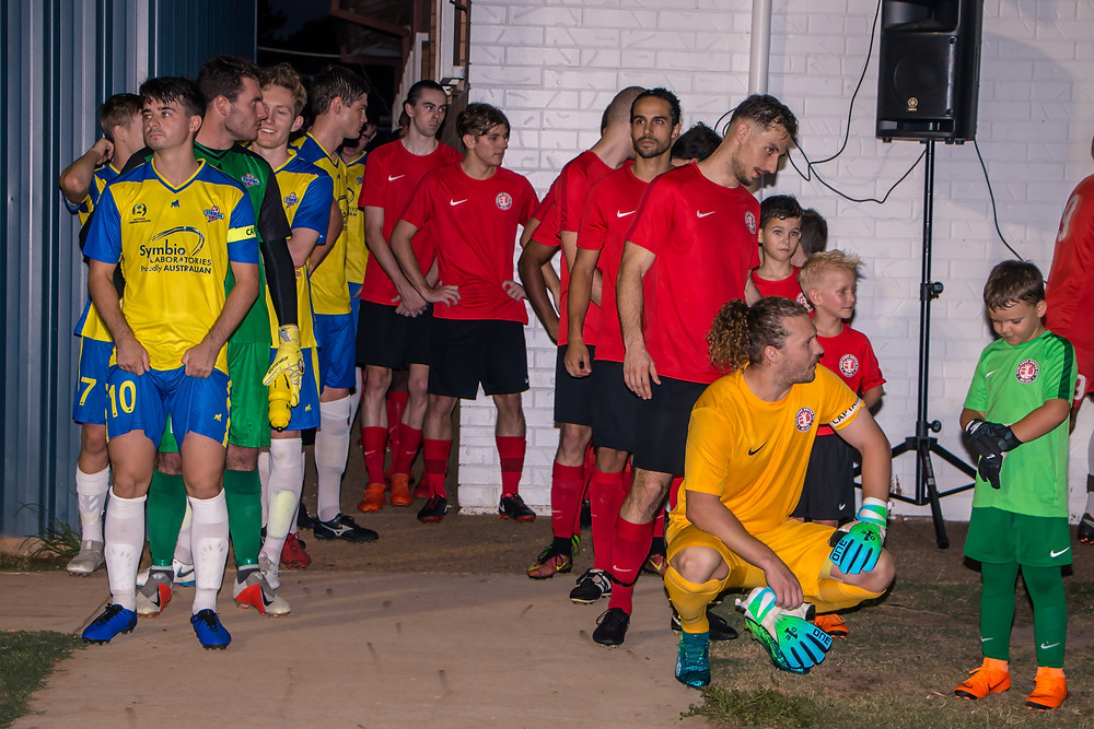 """"""" As the players lined up in preparation for Round 2 of the National Premier League Redlands Goalkeeper Jack Richards received encouragement from a young fan """"  Photo Ray Gardner"""