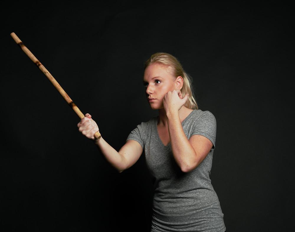 woman holding escrima stick
