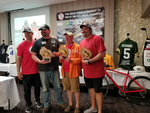 UW Men's hockey coach Mark Osiecki with the winning team.. in the walleye division of the Mark Osiecki Casting for Kids Muskie/Multi-Species Tournament! 6/01/2019