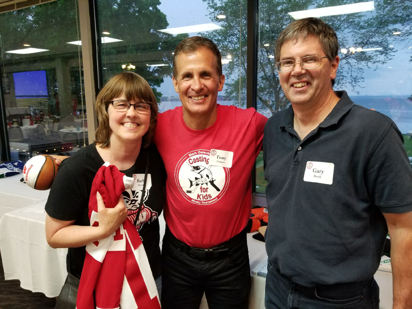 Barb Brock, Coach Tony Granato and Gary Brock are all smiles at this years Mark Osiecki Casting for Kids Muskie Tournament, Dinner and Banquet. 6/01/2019