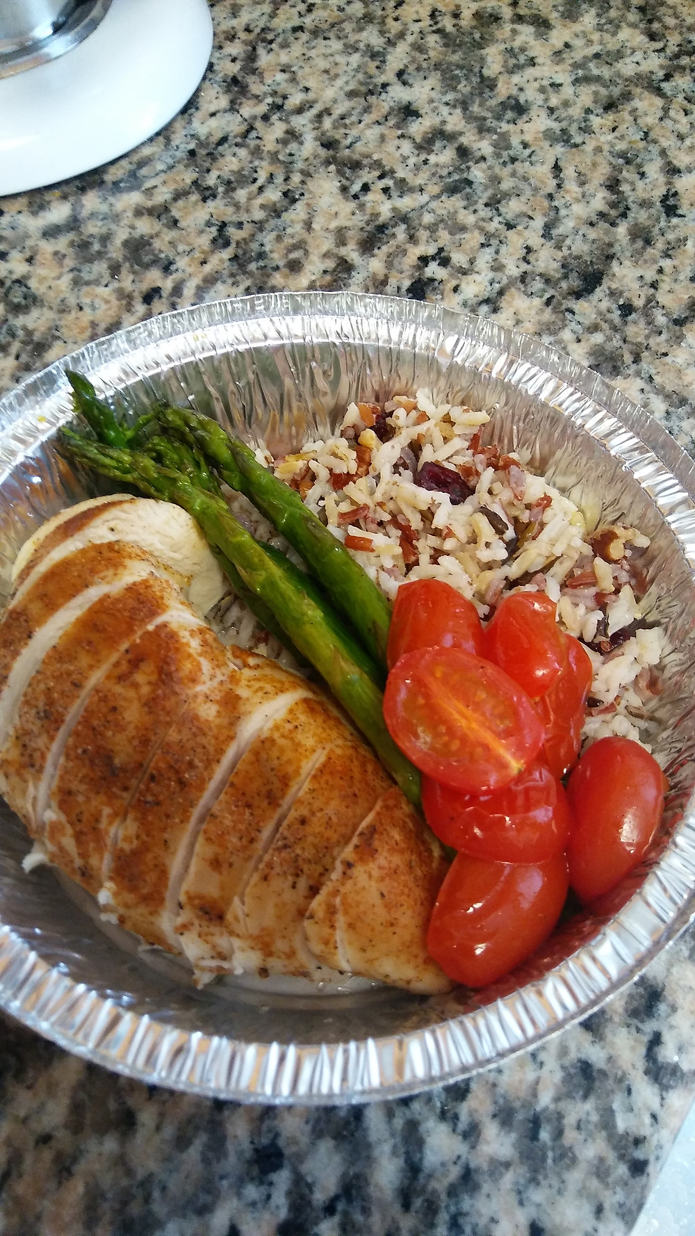 Spicy Cajun chicken breast served with roasted asparagus and tomatoes, wild rice blend infused with pecan and Craisins. Sodium 561 mg