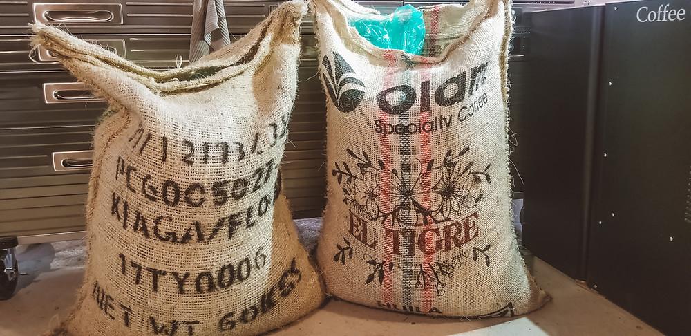 Green coffee beans in burlap sacks