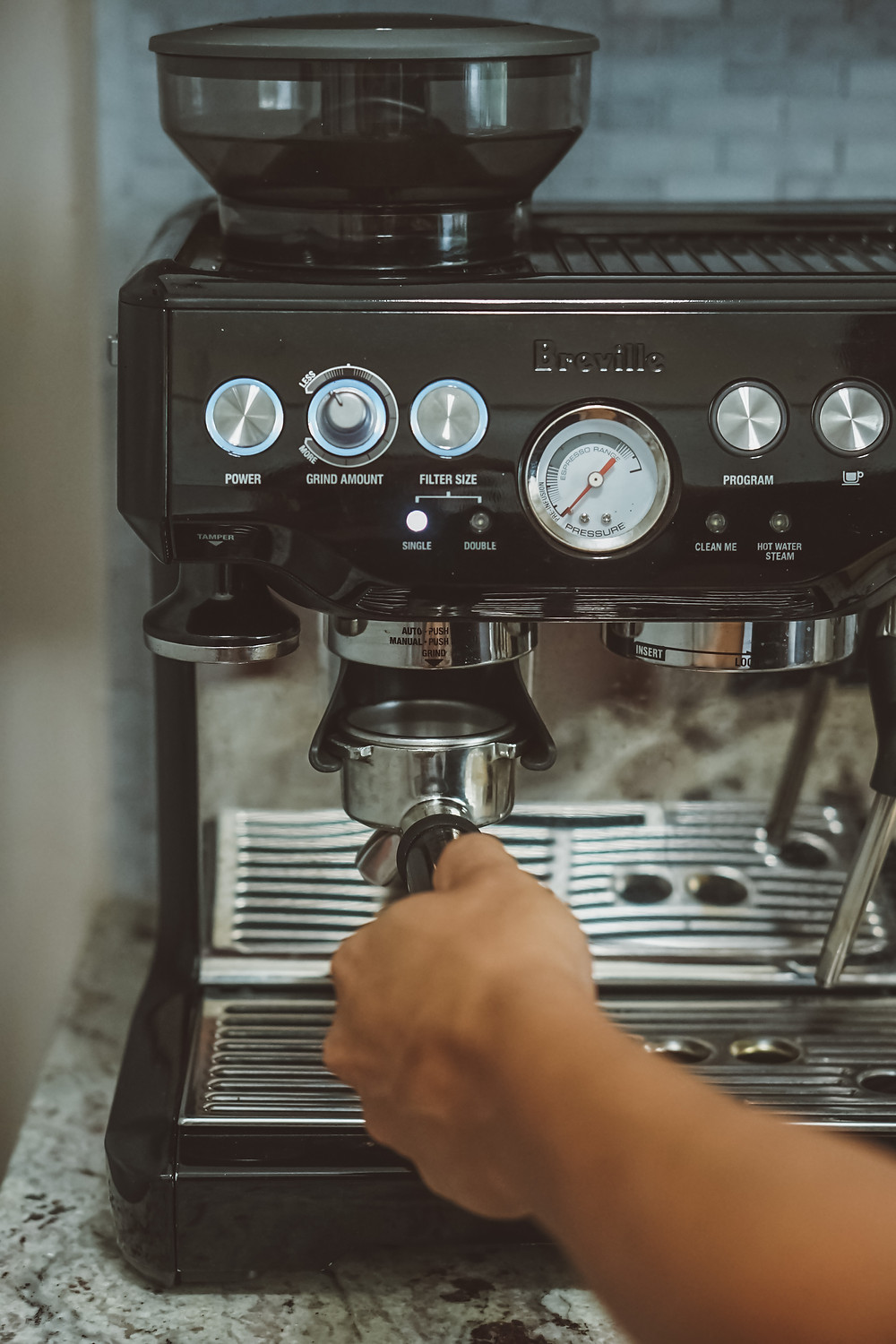 Grinding coffee on Breville Barista Express home espresso machine