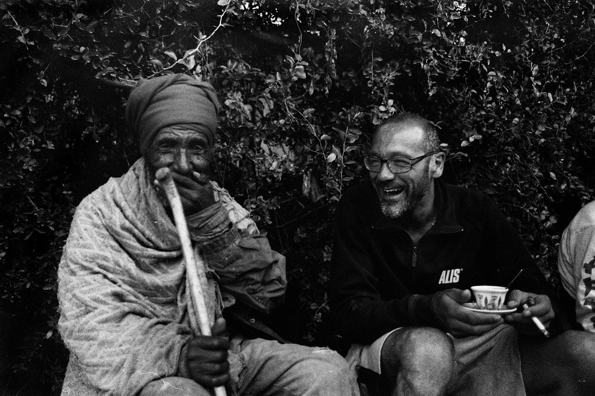 Albert on a coffee break with a local man.