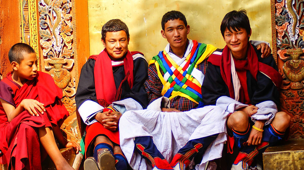 Young ceremonial Pazaap Warriors resting against a door in Punakha Dzong, Bhutan. Copyright, Bhutan Himalaya Expeditions