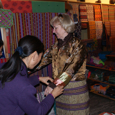 Guest trying on the national dress of Bhutan
