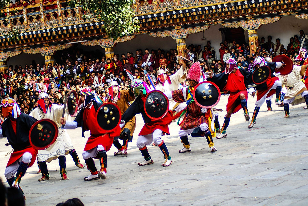 With drums and shields and swords, the warriors of Punakha perform their ancient martial dance at the Punakha Festival. Copyright, Bhutan Himalaya Expeditions