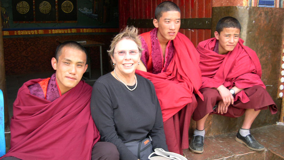 Bhutan Himalaya Expeditions visiting with local monks