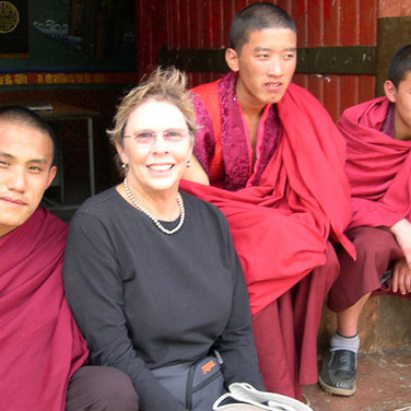 Guest Mimi M with local monks