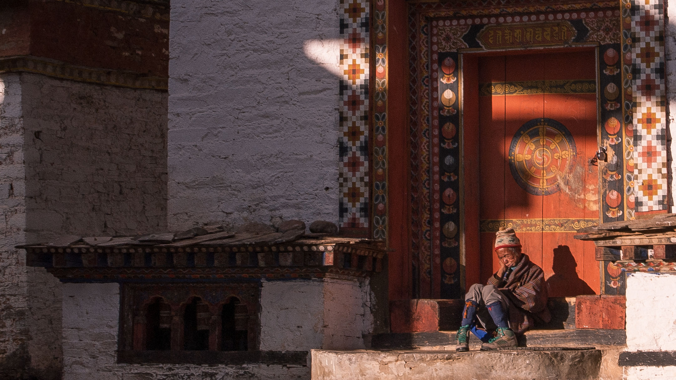 An old man naps in the medieval palace of Tang Orgyencholing, Bhutan,