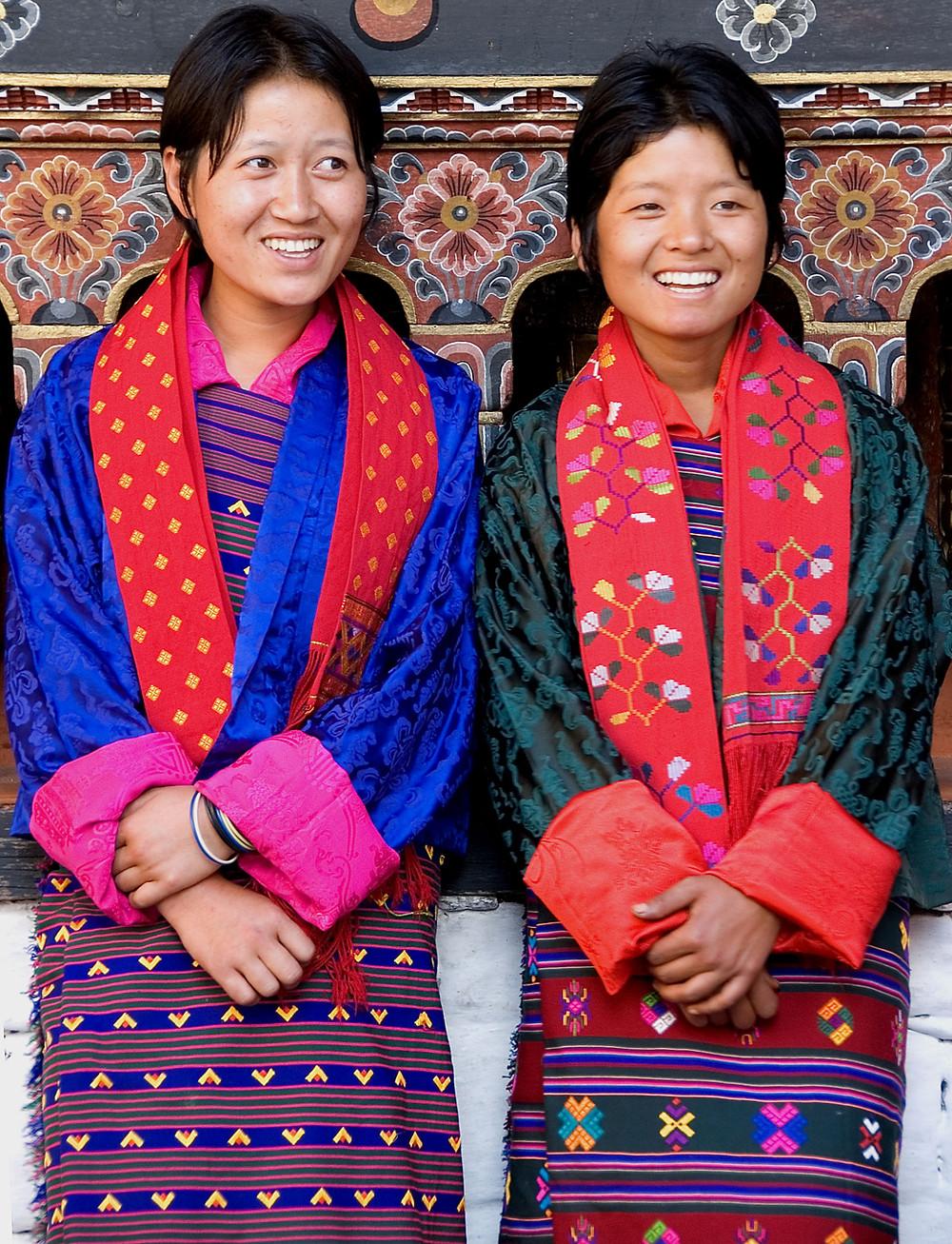 Young Bhutanese women wearing kira at tshechu festival