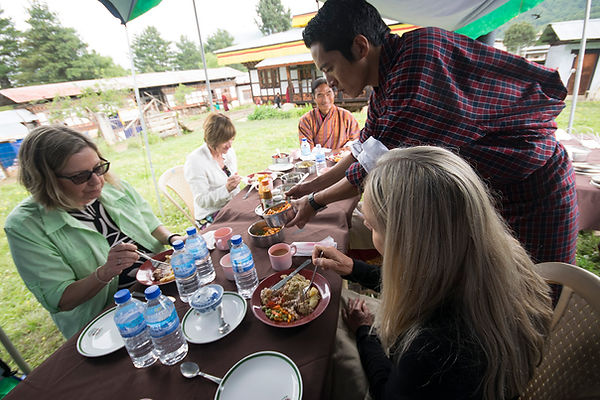 Our guides serving lunch to guests in a private tent