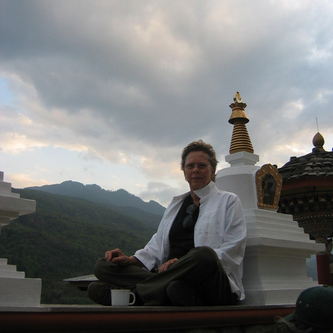 Contemplation beside a Buddhist stupa