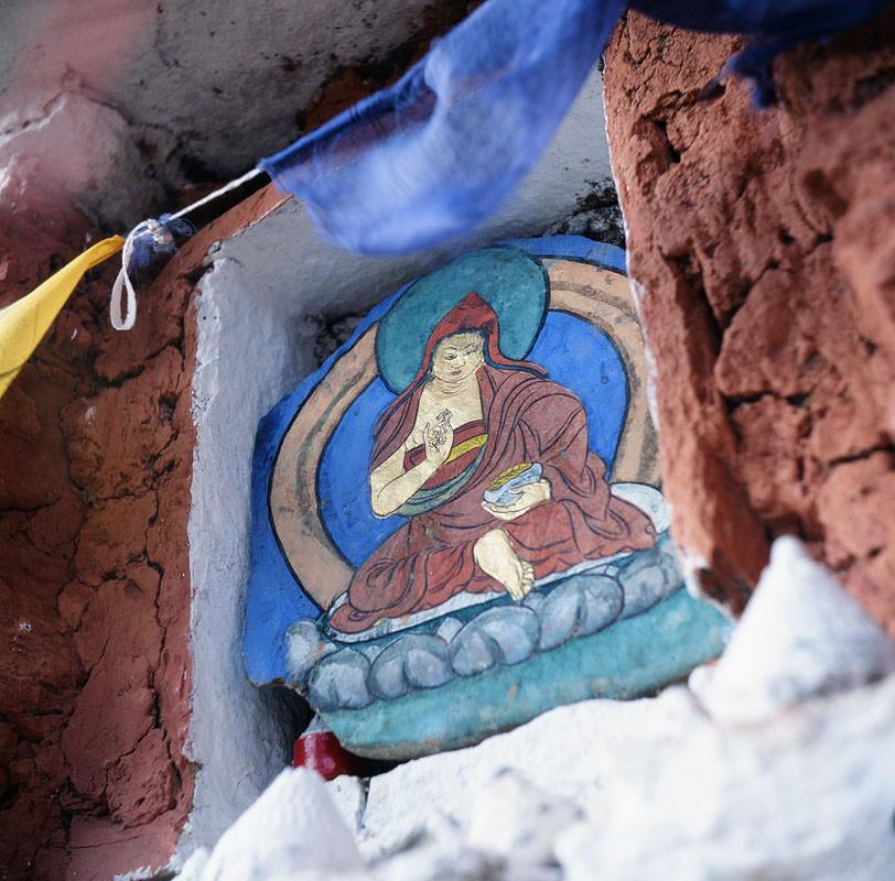 A stone painting of a Buddhist Arhat or teacher ona stupa wall in Bhutan