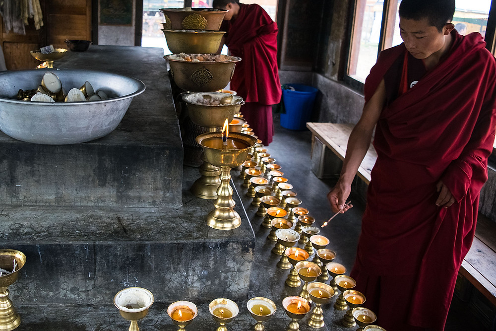 Devout Bhutanese Buddhists believe they gain merit by inviting monks to their homes and sharing the new year festivities, which include the lighting of auspicious butter lamps