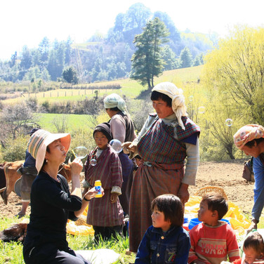 Guests enjoying farm-to-table day with villagers in Central Bhutan