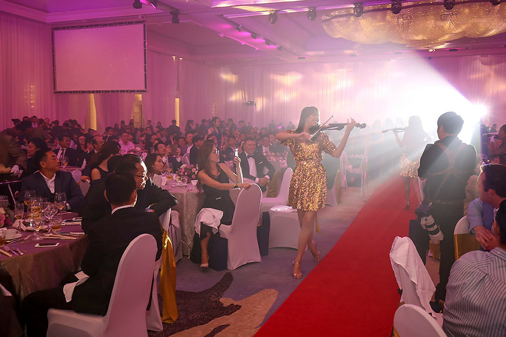 bianca from amadeus electric quartet playing the violin during a show in the audience in Kuala Lumpur for a company