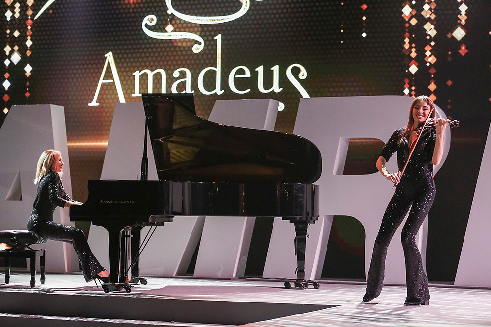 Large yamaha piano with Laura and Bianca from Amadeus playing live on stage during a show