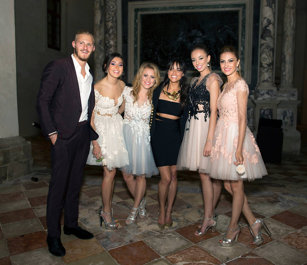 Amadeus Electric Quartet girls taking a photo with Michelle Rodriguez during a party in Venezia, Italy