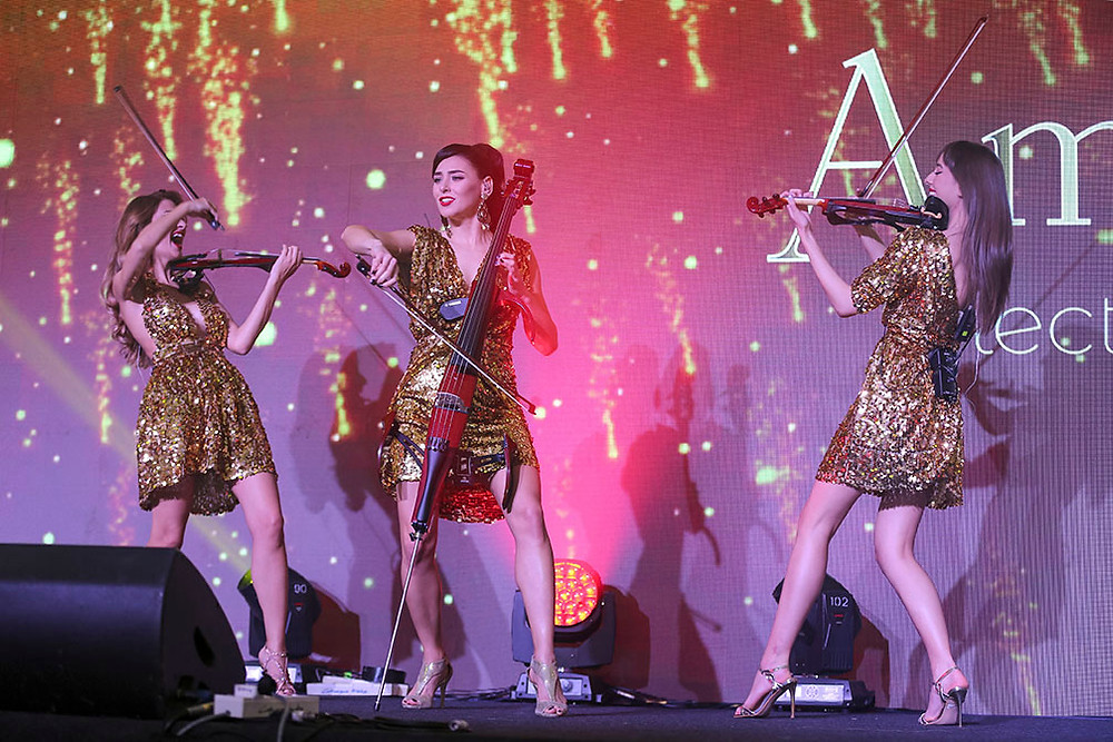 the girls from Amadeus Electric Quartet playing electric violins on stage
