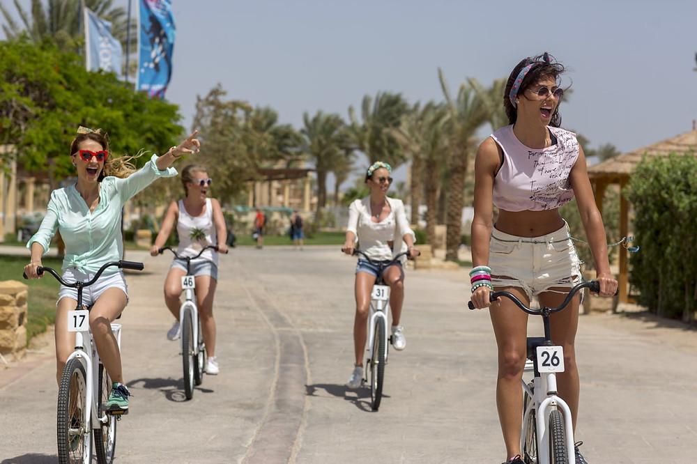 Amadeus Electric Quartet girls riding bikes in SomaBay seaside