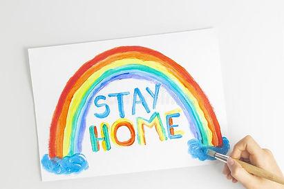 kid-painting-quarantine-home-rainbow-wor