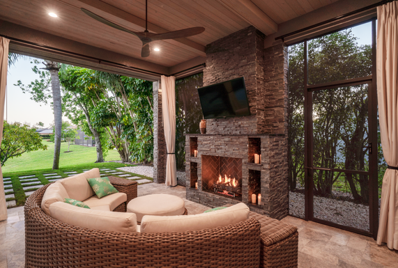 Custom Remodled Lanai with Beamed Ceiling, Roll-Away Screen, and Fireplace