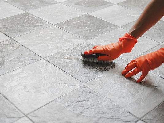 Tile and Grout Cleaning with Protective Gloves by Supercare Cleaning and Maintenance