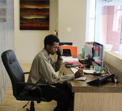 Lamar at desk (1).PNG