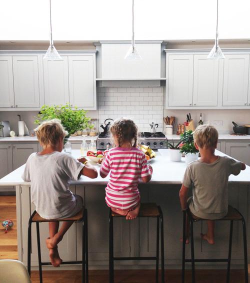 Kids sitting at kitchen bench