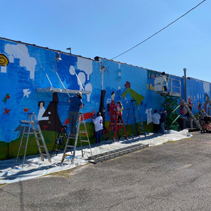 180 folks painted the 100-ft mural!