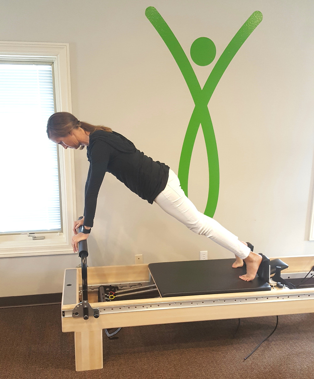 Angie exercising on the Pilates Reformer