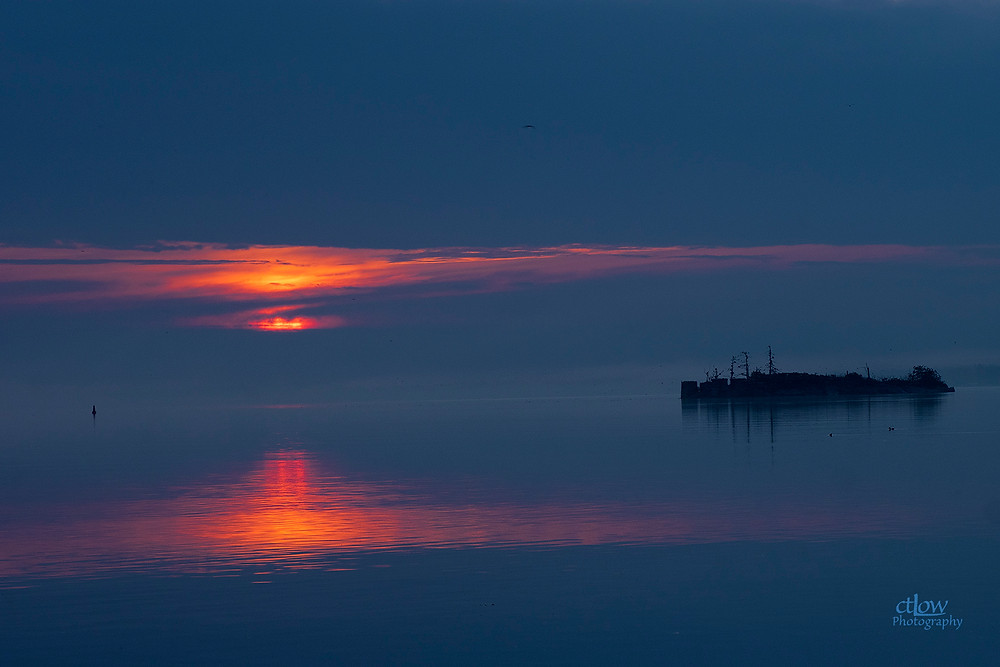 Sunrise cloud and fog St. Lawrence River Brockville Ontario