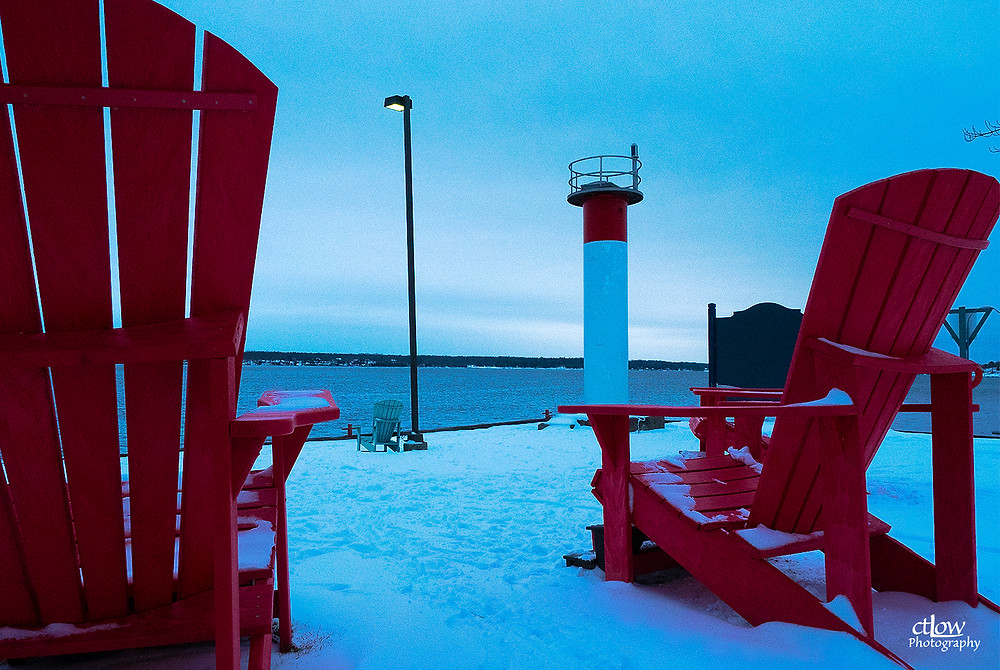 wide angle lens perspective distortion oversize Adirondack chairs Blockhouse Island Brockville Ontario winter snow