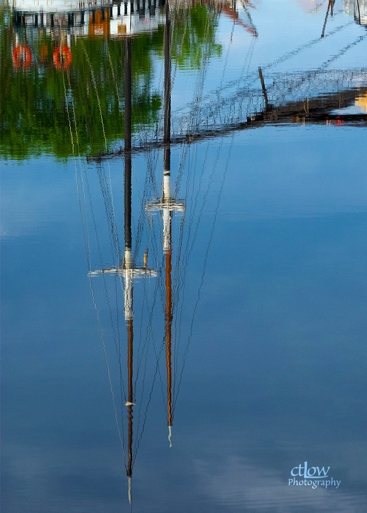 Black Jack tall ship reflected masts Tunnel Bay dawn Brockville Ontario