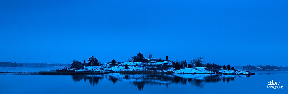 Thousand Chimney Island dawn reflection winter snow St. Lawrence River
