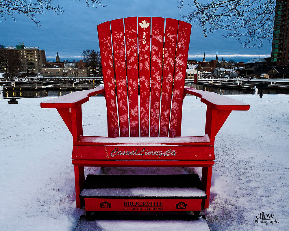 Oversize chair tourist attraction Blockhouse Island, Brockville, Ontario winter, snow