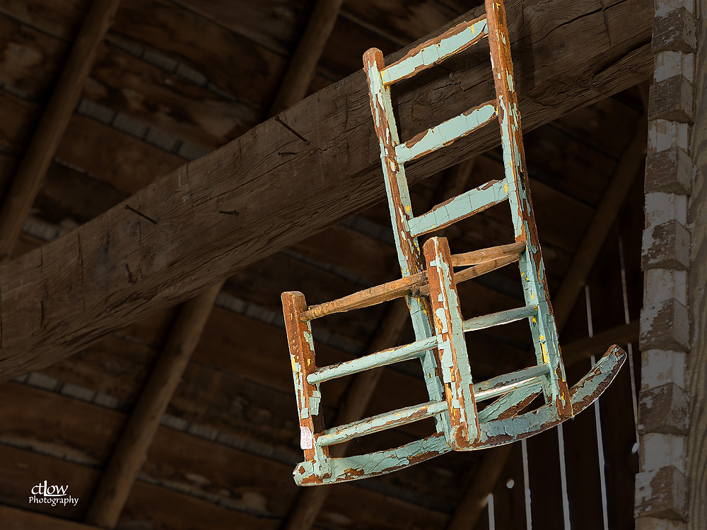 child's chair hanging in rafters