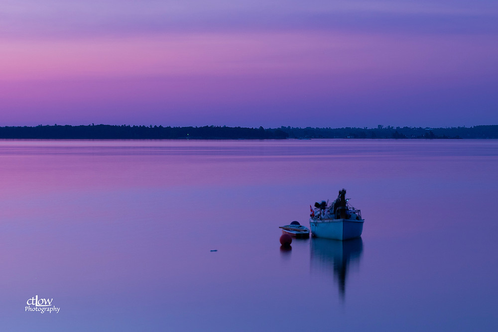 Sailboat overnighting anchor, flat-calm, St. Lawrence River