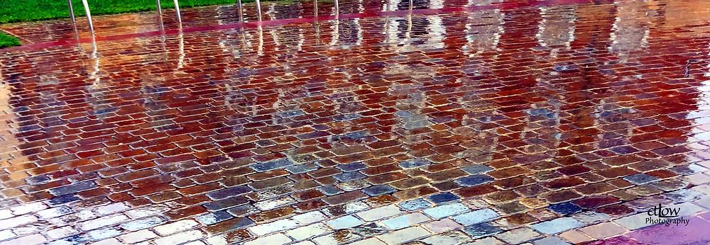 paving stone building reflection