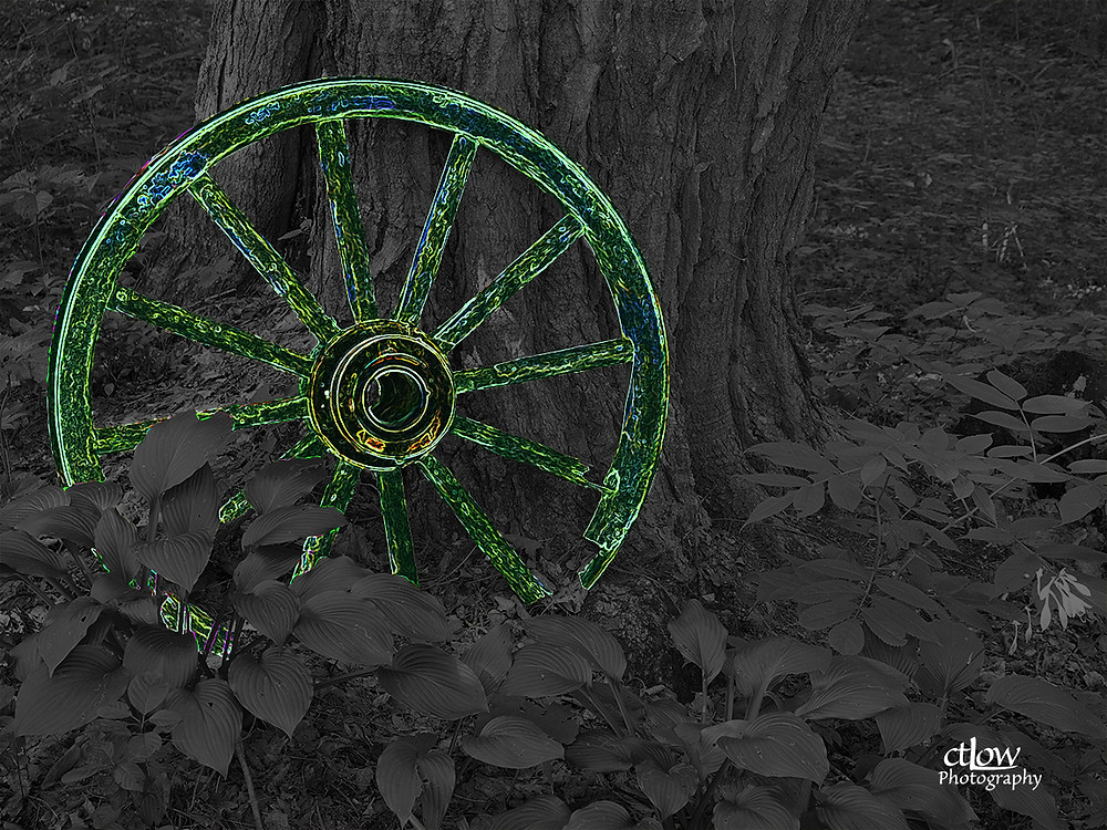 Wagon wheel in the woods - heavy, surreal editing