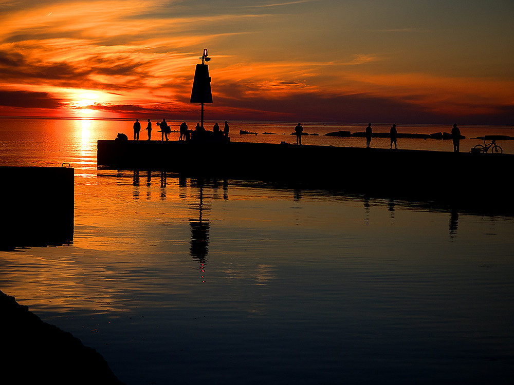 sunset over pier with fishing, bicycle