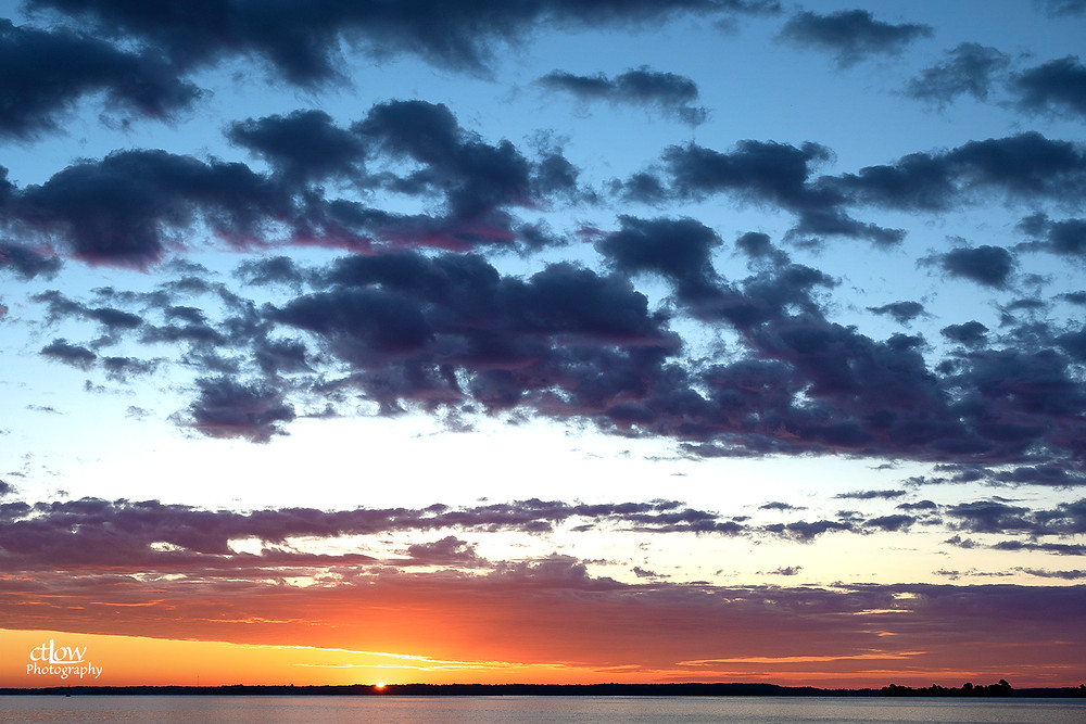 sunrise red clouds St. Lawrence River