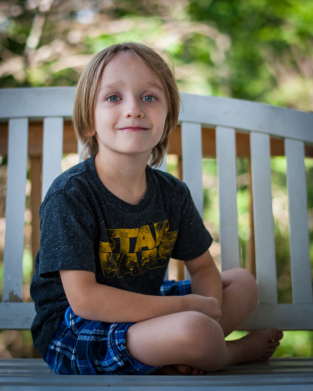 Child on porch - distracting background