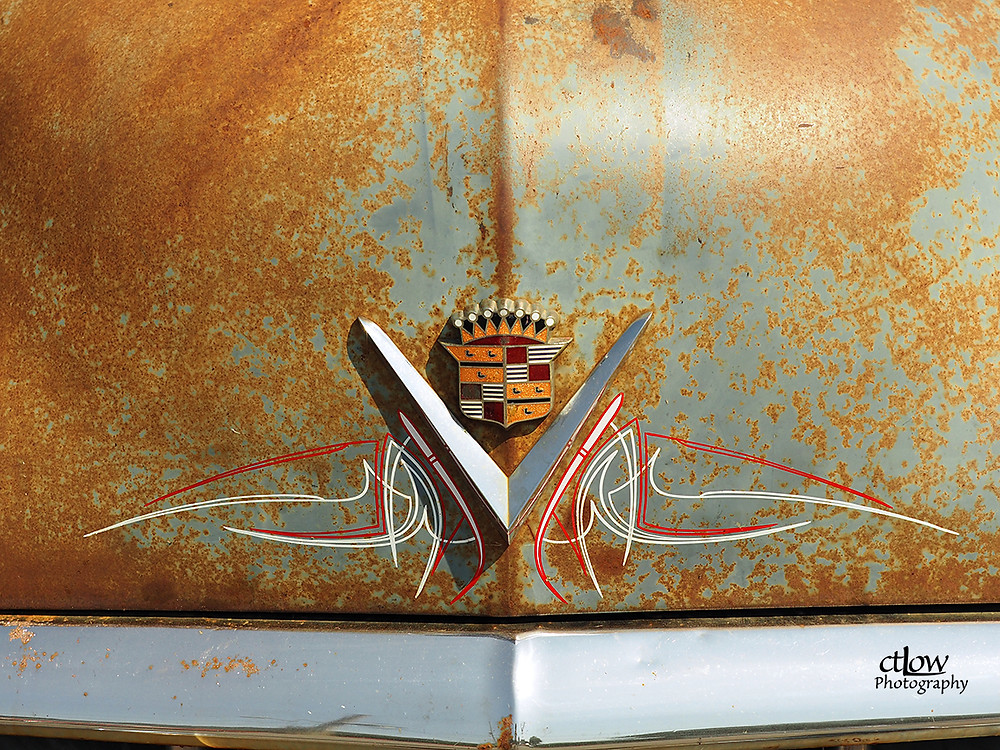 ornamentation graphics on rusty old Cadillac
