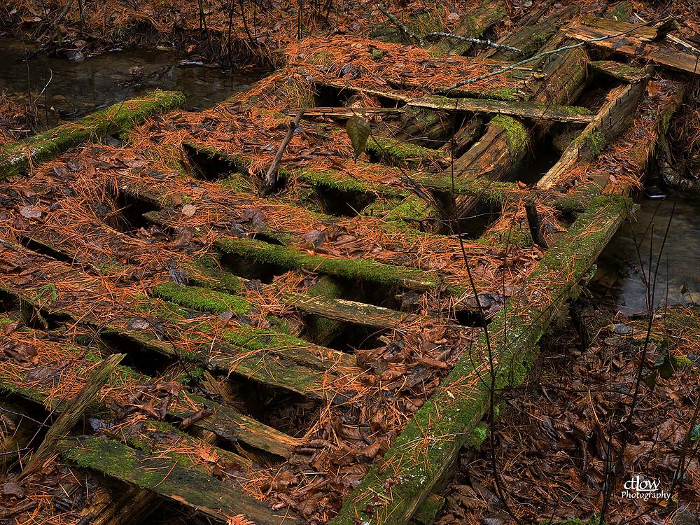 Crumbling wooden footbridge