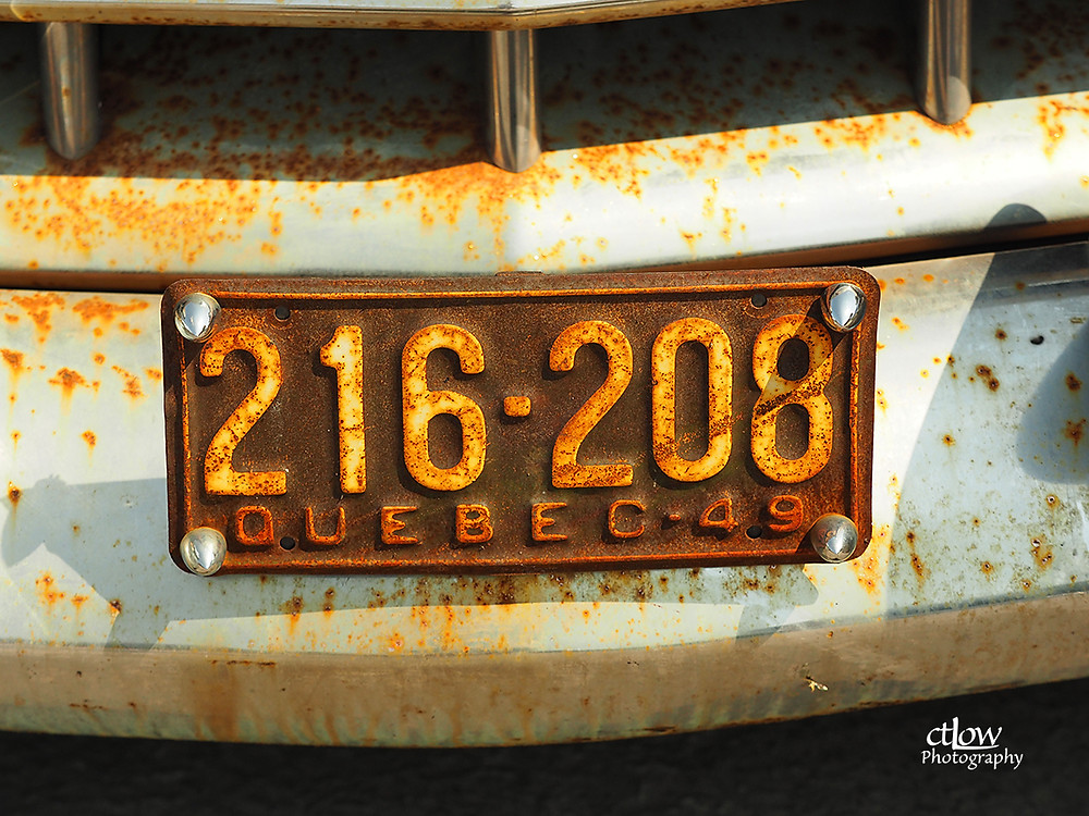 rusty old Quebec license plate, Cadillac